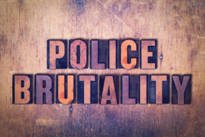 The words Police Brutality concept and theme written in vintage wooden letterpress type on a grunge background being used by a Granville Police Misconduct Lawyer.