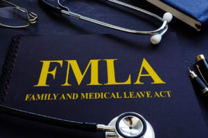 FMLA family and medical leave act and stethoscope being used by a Madison County FMLA Lawyer.