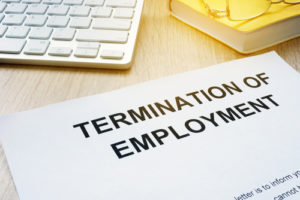 Termination of employment typed on a sheet of paper for a wrongful termination lawyer in Delaware County.