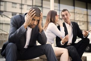Man upset from hearing his coworkers gossip, for reliable representation with your discrimination case speak to Newark Workplace Discrimination Attorney.