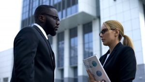 An African and a female employee having a conversation before contacting a Newark. discrimination attorney.