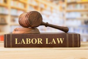 A labor law book with a gavel on top if it on the desk of a Columbus labor lawyer.