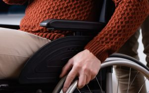 A person in a wheelchair representing how a Newark employment discrimination attorney can help you defend your rights.