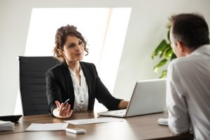 Woman speaking with boss about wage dispute